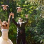 Newlyweds throwing chicken in the air